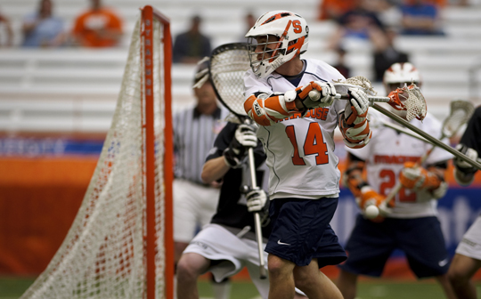 Senior co-captain Chris Daniello makes the Orange's first goal behind his back. Syracuse beat Providence 14-5 at the Carrier Dome on Saturday. Copyright 2010 Jamie De Pould/TheNewsHouse.com
